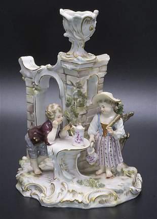 Figürlicher Handleuchter / A figural candlestick,