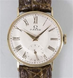 HAU / A 14k gold men's wrist watch, Omega, Schweiz, um