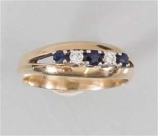 Damenring mit Diamant und Saphir / A ladies 14k gold