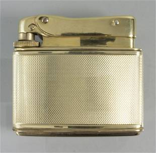 Gas-Feuerzeug in 14K Gold / A 14k gold gas lighter,