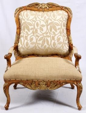 PAUL ROBERT CARVED WALNUT UPHOLSTERED ARM CHAIR