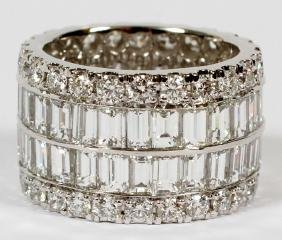 12.98CT DIAMOND AND 18KT WHITE GOLD ETERNITY RING