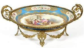 FRENCH PORCELAIN AND GILT METAL CENTERPIECE