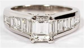 2.31CT EMERALD AND BAGUETTE CUT DIAMOND RING