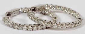 DIAMOND AND 14KT WHITE GOLD HOOP EARRINGS PAIR