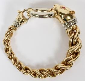 ITALIAN YELLOW GOLD AND RUBY TWIST PANTHER BRACELET