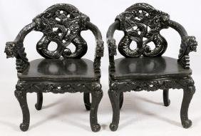 CHINESE CARVED EBONIZED WOOD ARM CHAIRS PAIR
