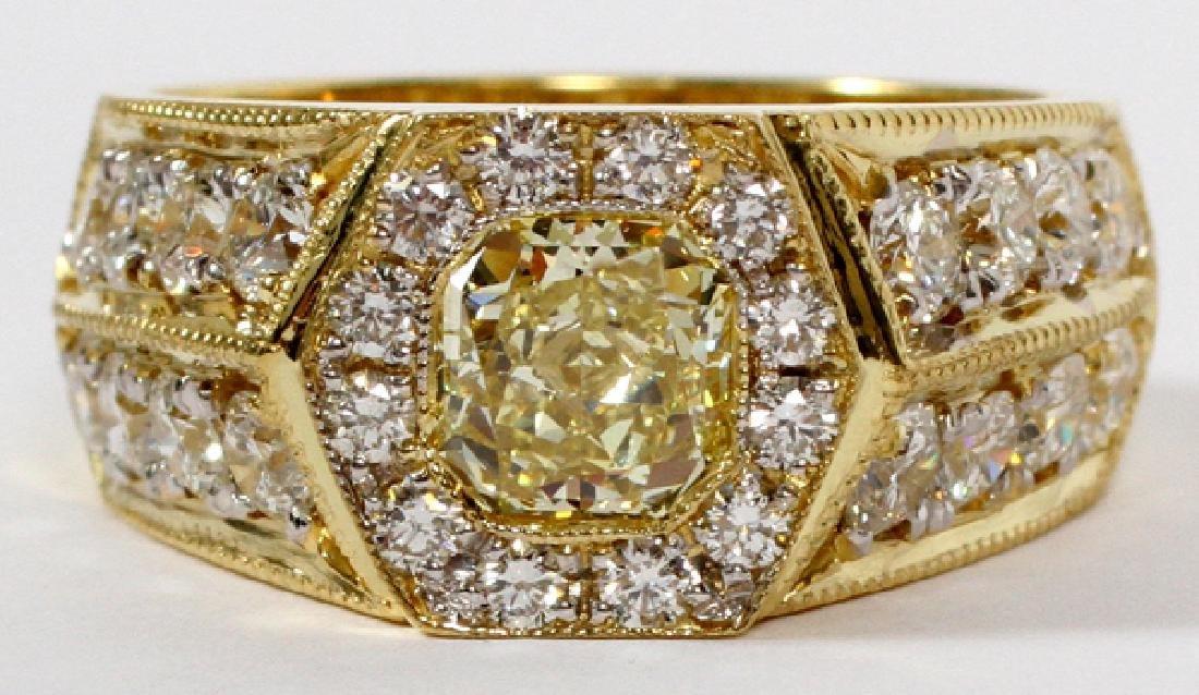 1.06CT FANCY YELLOW DIAMOND 18KT YELLOW GOLD RING