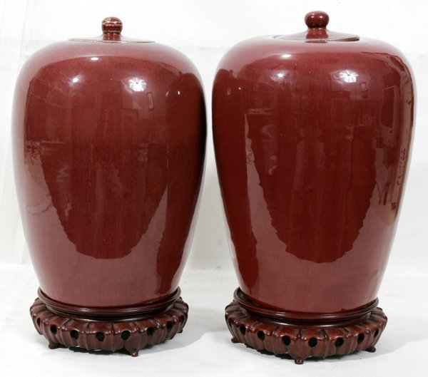 090002: CHINESE 'SANG DE BOEUF' PORCELAIN COVERED URNS