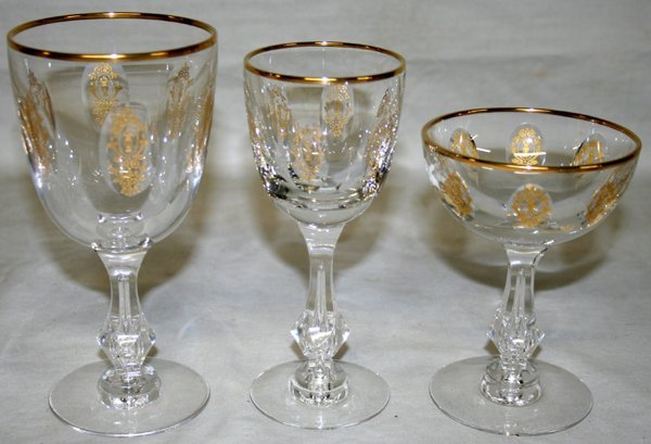 100006: FIRED GOLD & CRYSTAL STEMWARE SERVICE FOR 13