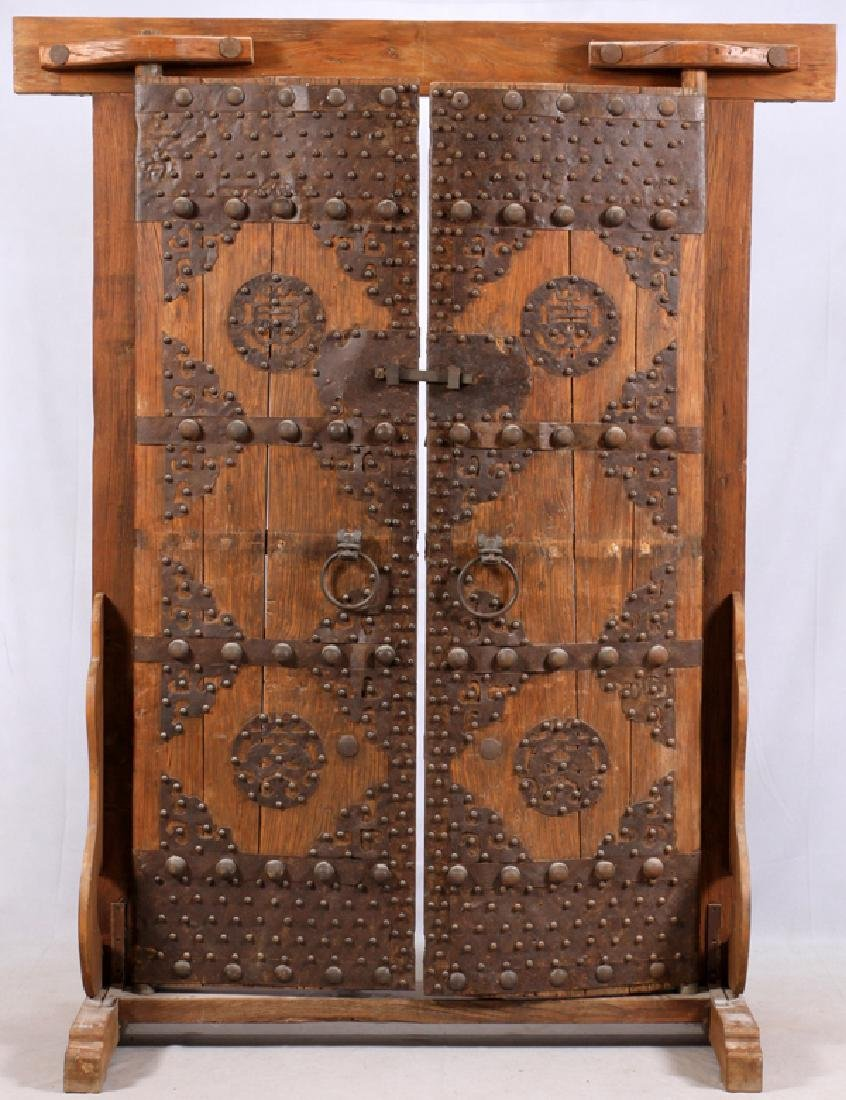 CHINESE HARDWOOD AND IRON MOUNTED TEMPLE DOORS