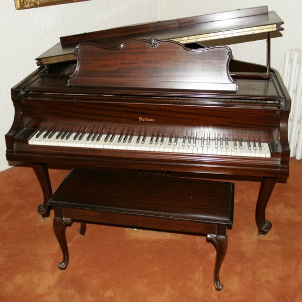 111011: BALDWIN CARVED MAHOGANY BABY GRAND PIANO