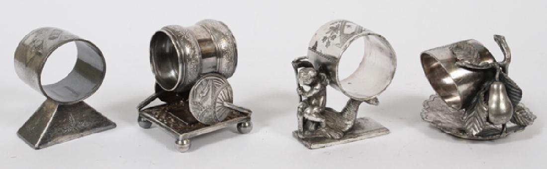 VICTORIAN FIGURAL SILVER PLATE NAPKIN RINGS