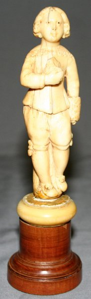 011437: CARVED IVORY FIGURE OF A BOY, H4.5""