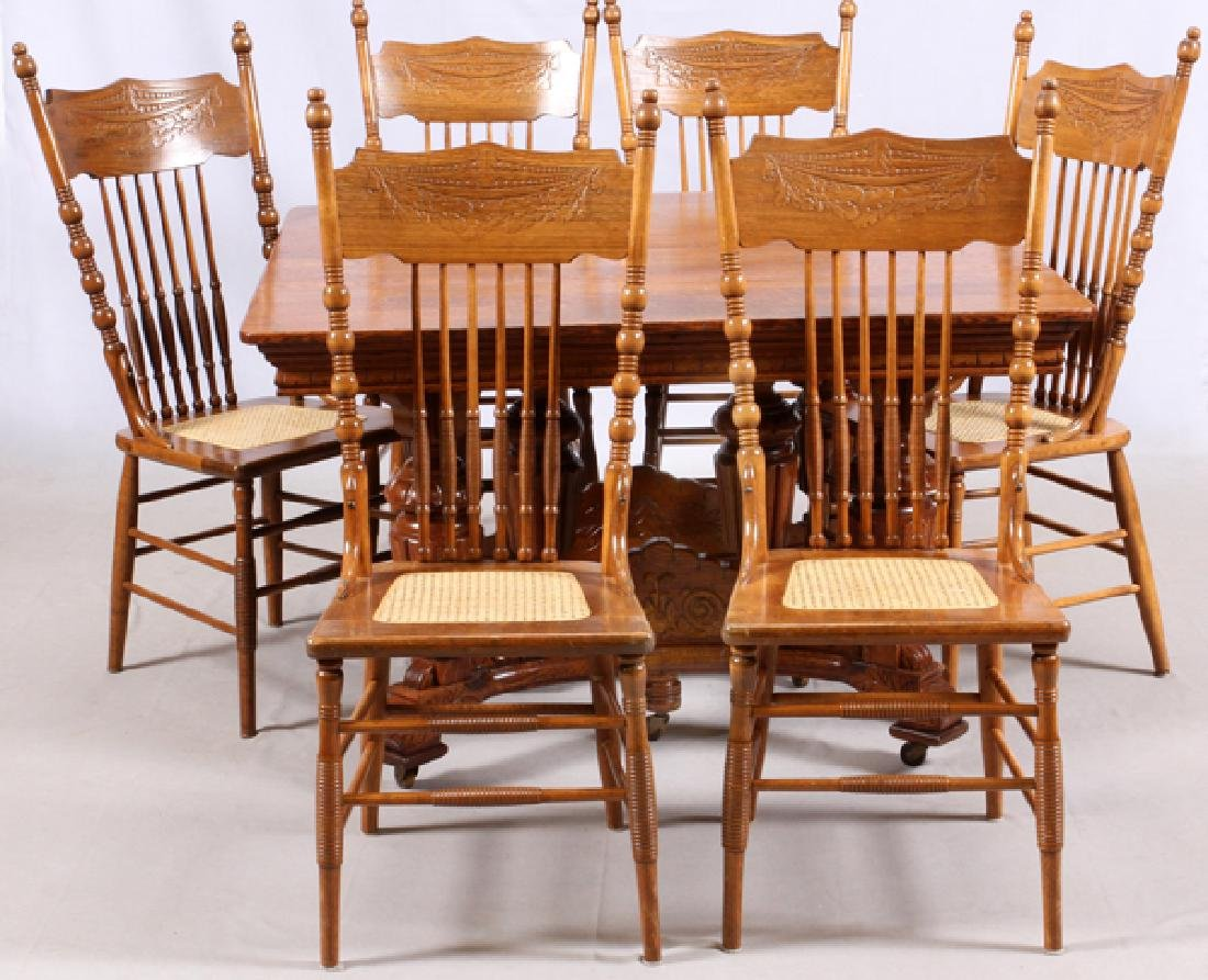 VICTORIAN OAK TABLE AND PRESSED BACK CHAIRS C.1900