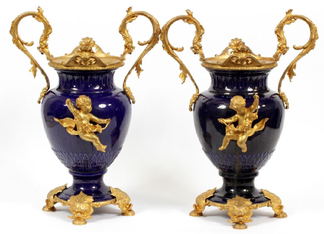 FRENCH COBALT BLUE PORCELAIN AND BRONZE URNS PAIR
