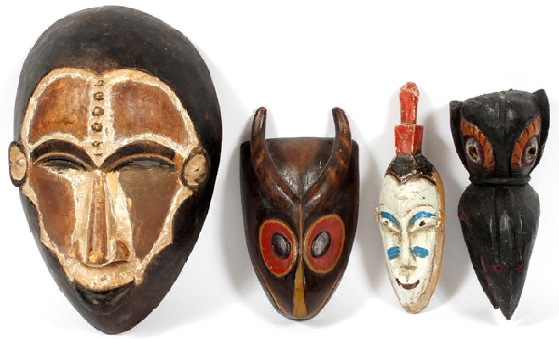 AFRICAN AND INDONESIAN CARVED WOOD MASKS FOUR