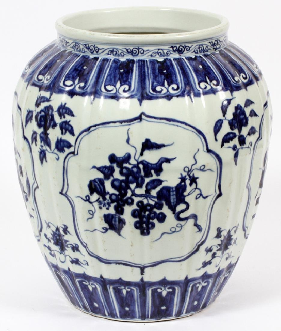CHINESE FLORAL BLUE AND WHITE PORCELAIN URN