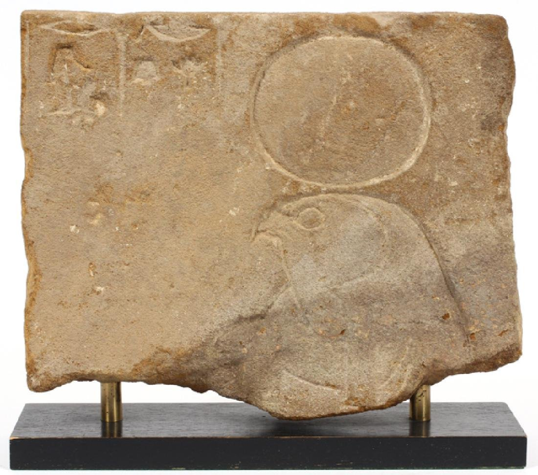 EGYPTIAN SANDSTONE RELIEF FRAGMENT OF RA-HORAKHTY