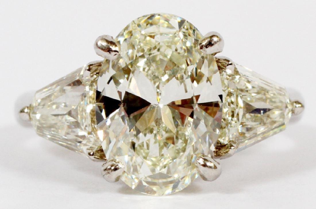 SOLITARY DIAMOND, SIDE DIAMONDS, PLATINUM RING