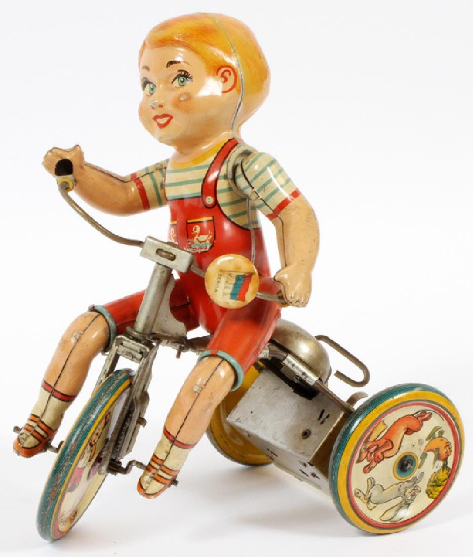 UNIQUE ART WIND-UP TIN TOY CIRCA 1950