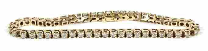 DIAMOND AND 14 KT YELLOW GOLD  TENNIS BRACELET