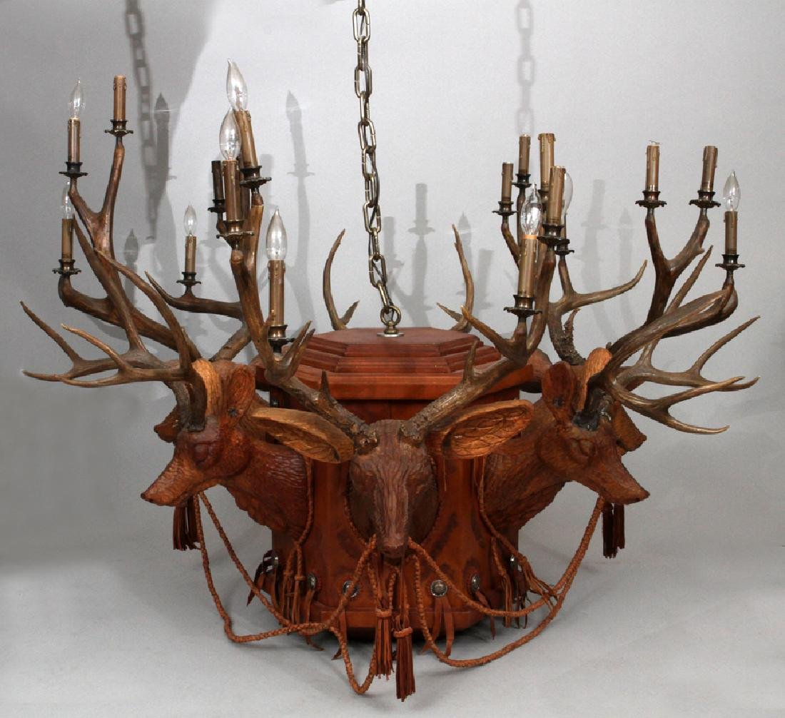 CARVED WOOD DEER HEADS AND LEATHER CHANDELIER