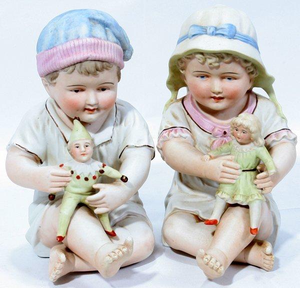 """080365: PORCELAIN BISQUE PIANO BABIES, 2 PCS., H8"""""""