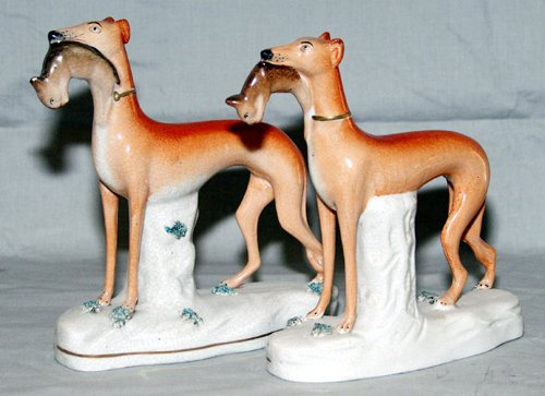 0005: ENGLISH STAFFORDSHIRE POTTERY FIGURES OF HOUNDS,
