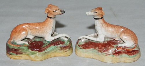 0010: ENGLISH STAFFORDSHIRE POTTERY FIGURES OF RECLININ