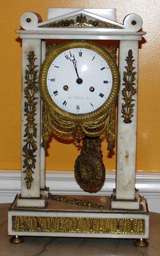 0021: FRENCH EMPIRE MARBLE & D'ORE BRONZE MANTEL CLOCK,