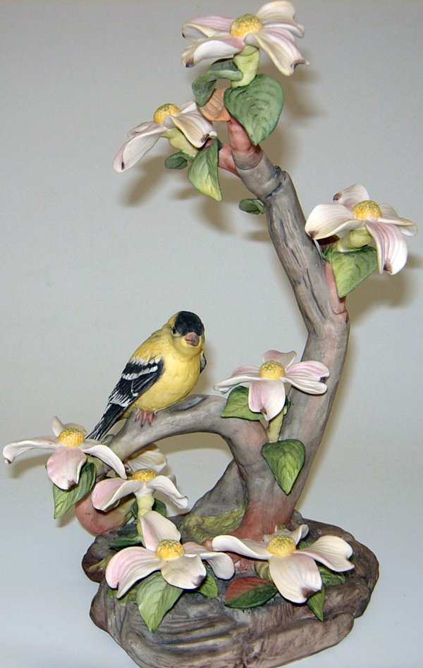 "113451: BISQUE FIGURE 'GOLDFINCH ON DOGWOODS' H12"" W8"""
