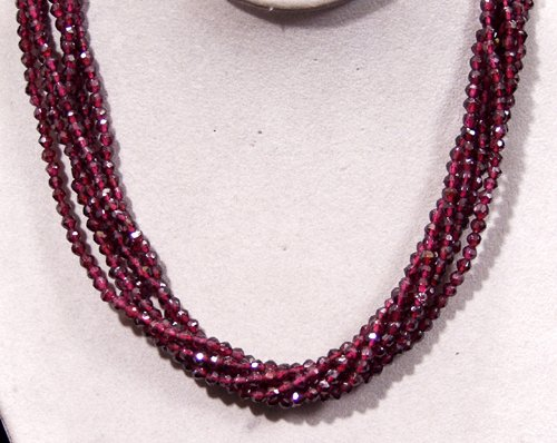 2411: GARNET SIX STRAND SILVER NECKLACE, FACETED STONES