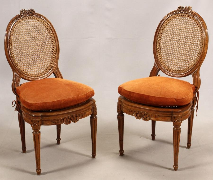 LOUIS XVI PAIR WALNUT AND CANE BACK SIDE CHAIRS