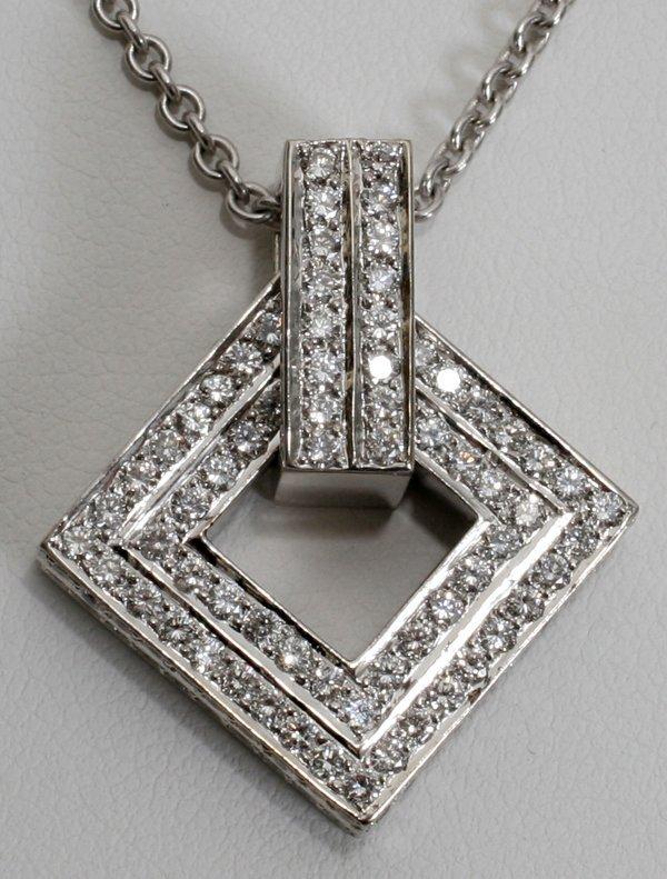 040024: DIAMOND & 14 KT WHITE GOLD PENDANT ON A CHAIN