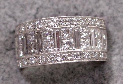 120012: PRINCESS CUT DIAMOND ETERNITY PLATINUM RING, 3.