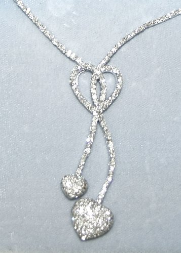 120017: 18KT WHITE GOLD & 4.00CT DIAMOND TOTAL WEIGHT N