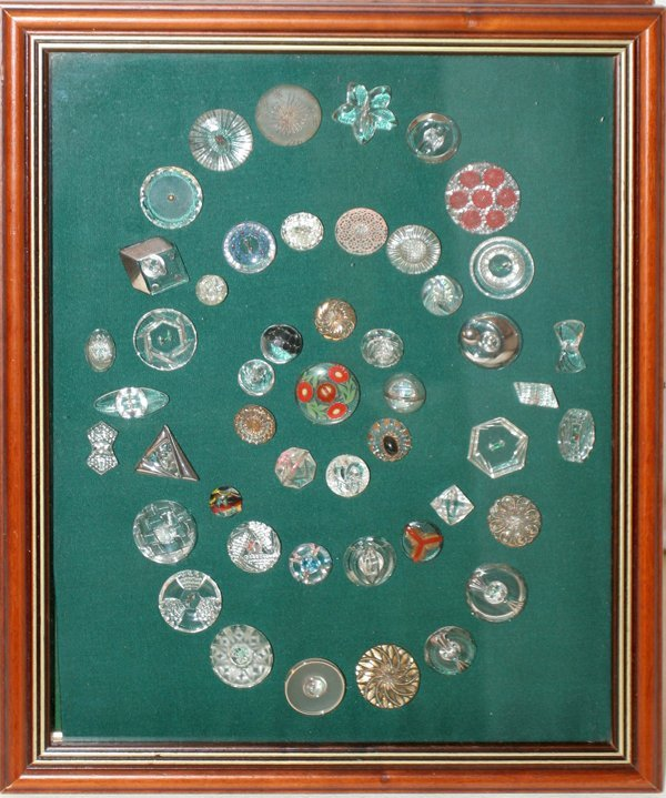 093009: CLEAR BUTTONS, APPROXIMATELY 45 , FRAMED