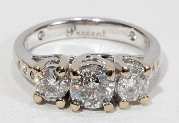 100005: RING W/THREE DIAMONDS, TOTAL 1.80 CTS
