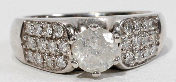 100017: 1 CT. ROUND DIAMOND RING W/ENHANCEMENTS