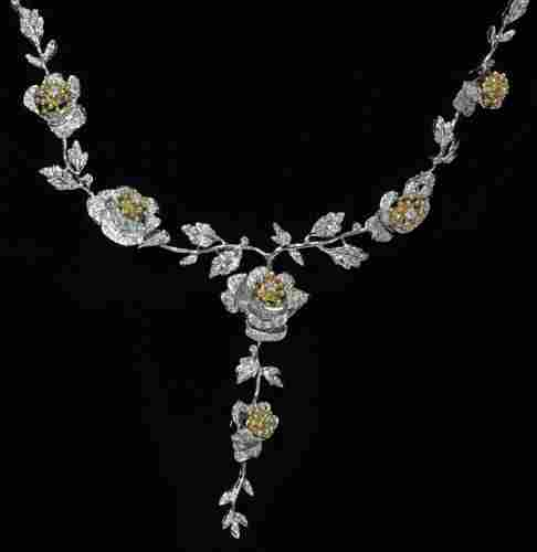 18 KT. TWO-TONE GOLD AND DIAMOND NECKLACE
