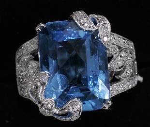 14 KT. WHITE GOLD, DIAMOND & BLUE TOPAZ RING