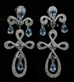 14 KT. WHITE GOLD, DIAMOND & BLUE TOPAZ EARRING