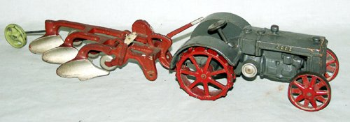 020187: CAST CASE METAL TOY TRACTOR AND PLOW, C. 1920,