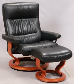 BLACK LEATHER ECKORNES CHAIR AND OTTOMAN