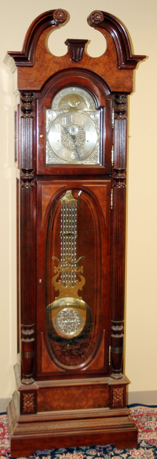 020025: HOWARD MILLER MAHOGANY GRANDFATHER CLOCK
