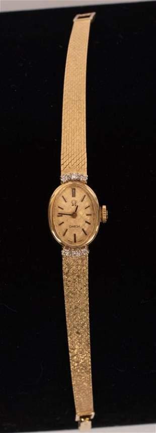 OMEGA 14KT GOLD & DIAMOND LADY'S WRIST WATCH, C. 1980,