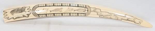102443: INUIT WALRUS TUSK CRIBBAGE BOARD SCRIMSHAW