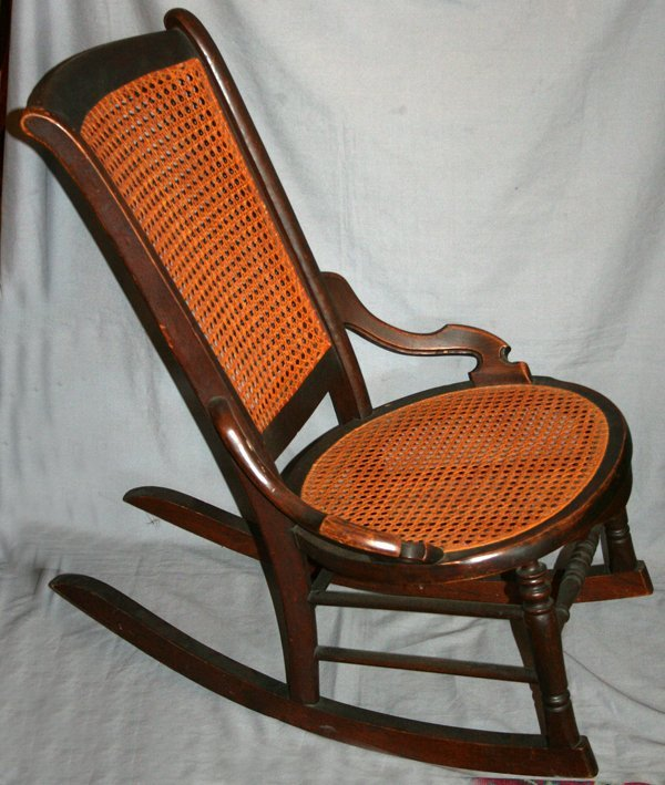 010515: AMERICAN ANTIQUE WOOD AND CANE ROCKING CHAIR