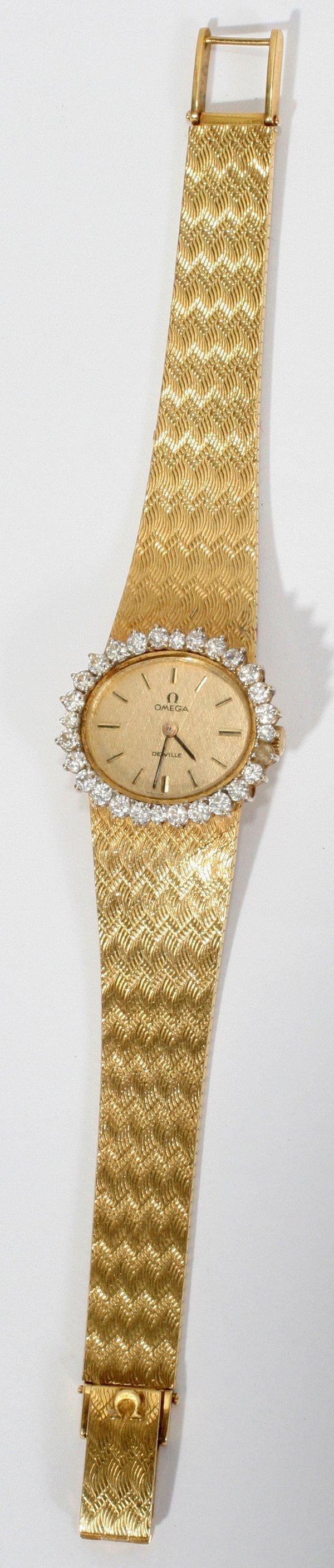 022181: OMEGA LADY'S 18 KT Y/GOLD & DIAMOND WRIST WATCH